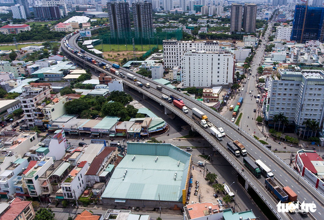 A smooth curve. A traffic jam seen from above on the connecting road of Phu My Bridge in District 7.