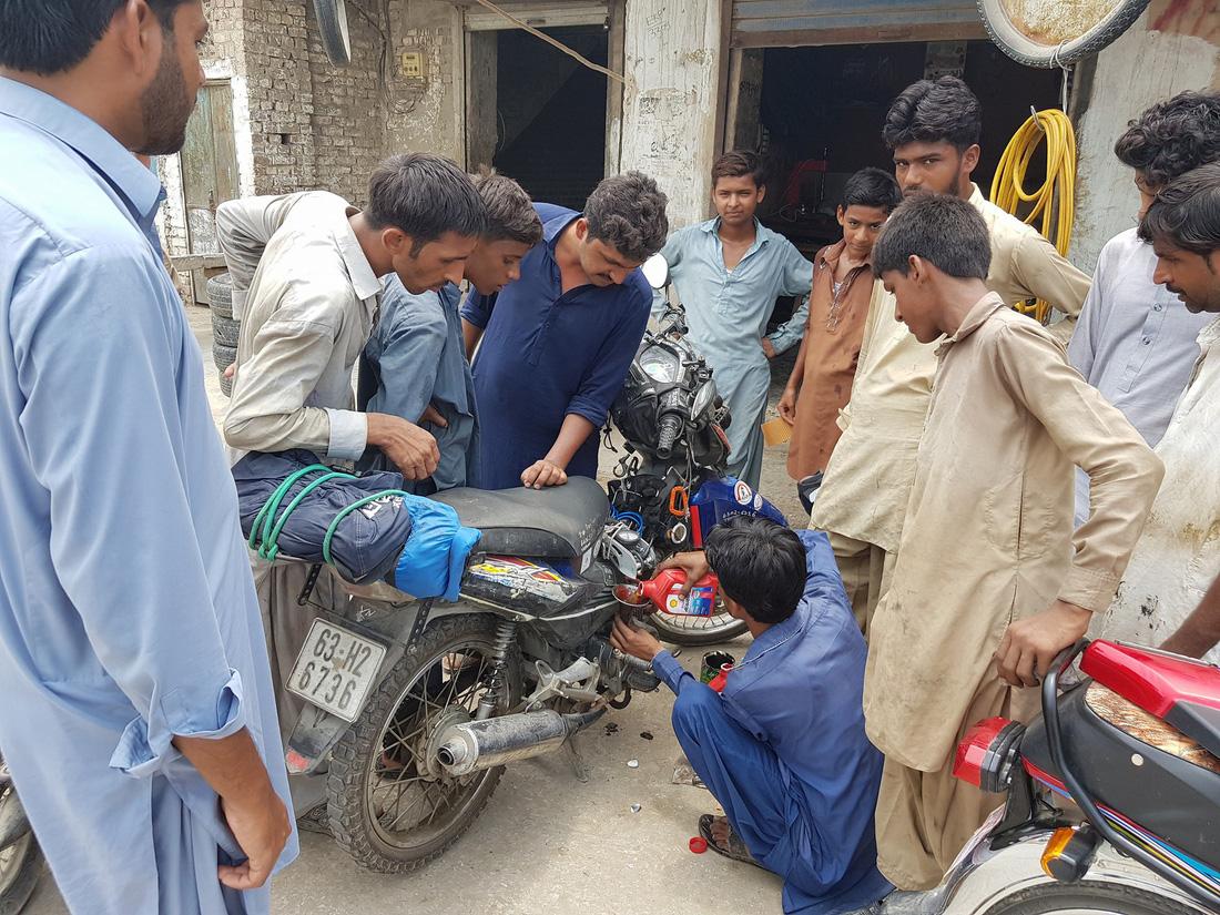 Changing oil in Sukkur, Pakistan