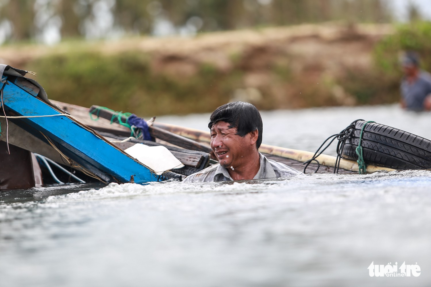 Vo Chut tries to save his ship from sinking in Van Phuoc Commune, Van Ninh District.