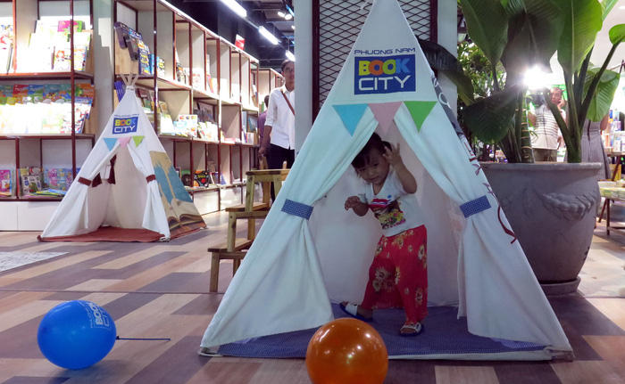 Tents are set up as a playground for children. Photo: Tuoi Tre