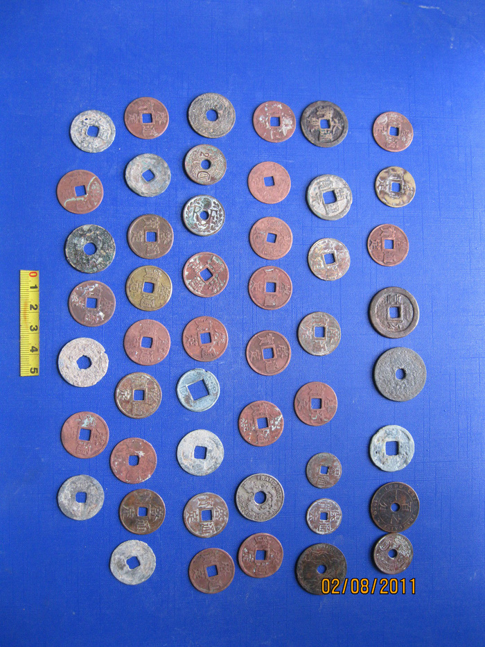 Ancient Vietnamese coins unearthed from the Vuon Chuoi archeological site in Hanoi. Courtesy of Dr. Nguyen Van Huy