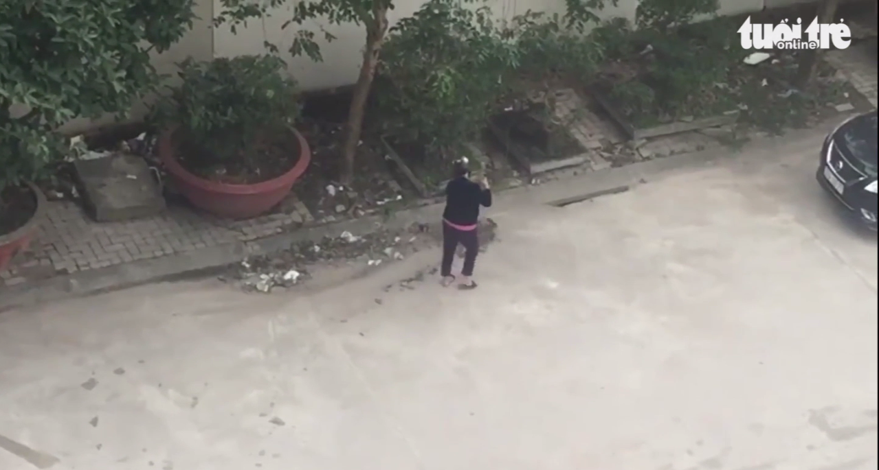 Vietnamese woman fined after being caught sweeping trash down sewer