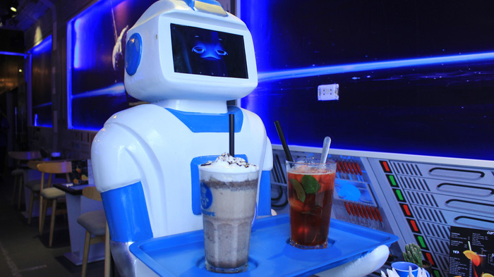 A robot is seen serving coffee at a coffee shop in Hanoi. Photo: Tuoi Tre