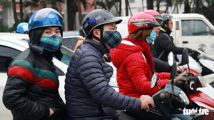 Commuters put on warm clothes to protect themselves against the chilly weather.