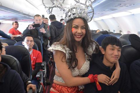Vietnam culture ministry to probe bikini show on plane carrying U23 footballers home