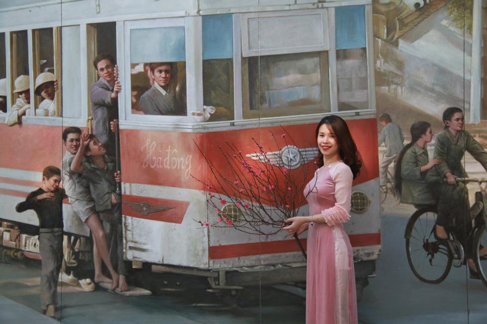A mural of a past tram in Hanoi. Photo: Tuoi Tre