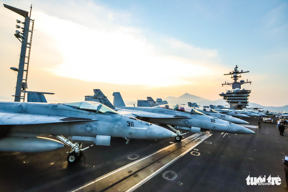 Different aircraft are seen on the deck of the USS Carl Vinson, docking off Da Nang City, central Vietnam, on March 5, 2018. Photo: Nguyen Khanh/Tuoi Tre