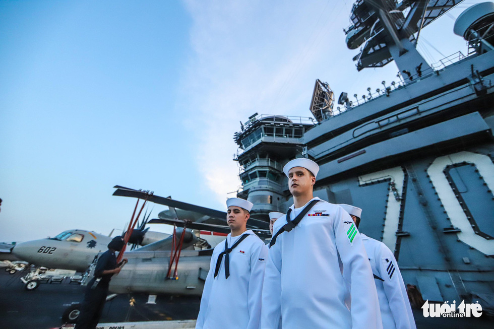 USS Carl Vinson crew members are pictured at work. Photo: Nguyen Khanh/Tuoi Tre