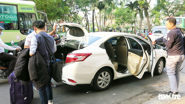 Vietnam drivers rush to sell cars, seek account transfer after Grab's takeover of Uber