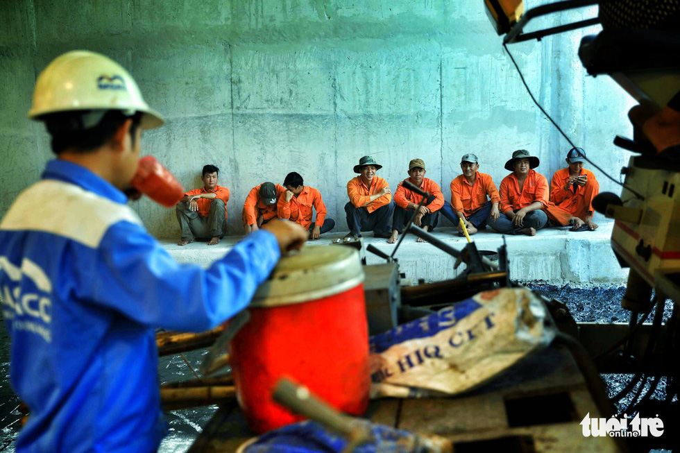 Workers take a break inside the first branch of the An Suong underpass in Ho Chi Minh City. Photo: Tuoi Tre