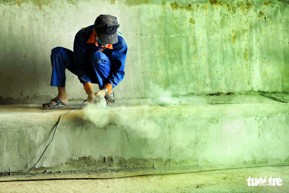 A worker finishes a concrete curb inside the first branch of the An Suong underpass in Ho Chi Minh City. Photo: Tuoi Tre