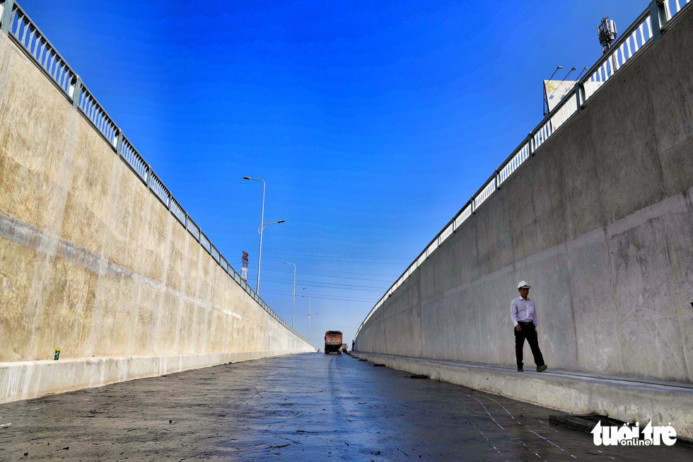 A man walks down the first branch of the An Suong underpass in Ho Chi Minh City. Photo: Tuoi Tre