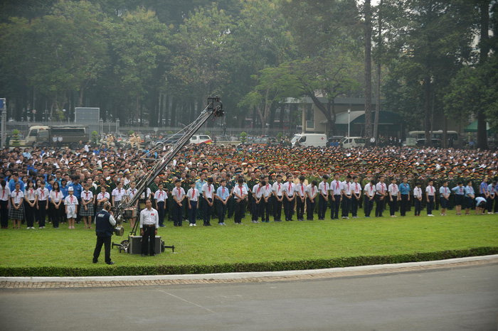 Thousands of people gather at the Reunification Palace to attend the ceremony.