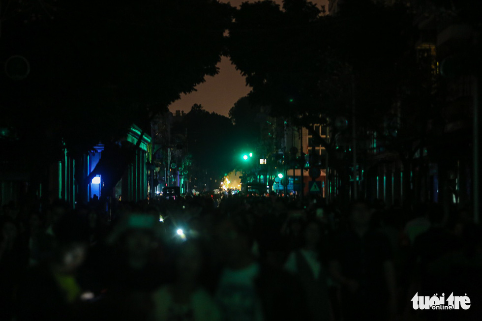 Lights are switched off along a street in Hanoi.