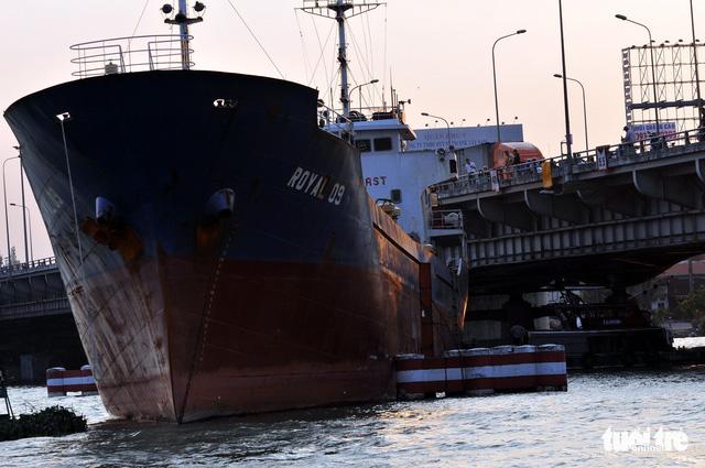 Cargo ship crashes into bridge following anchor loss in southern Vietnam