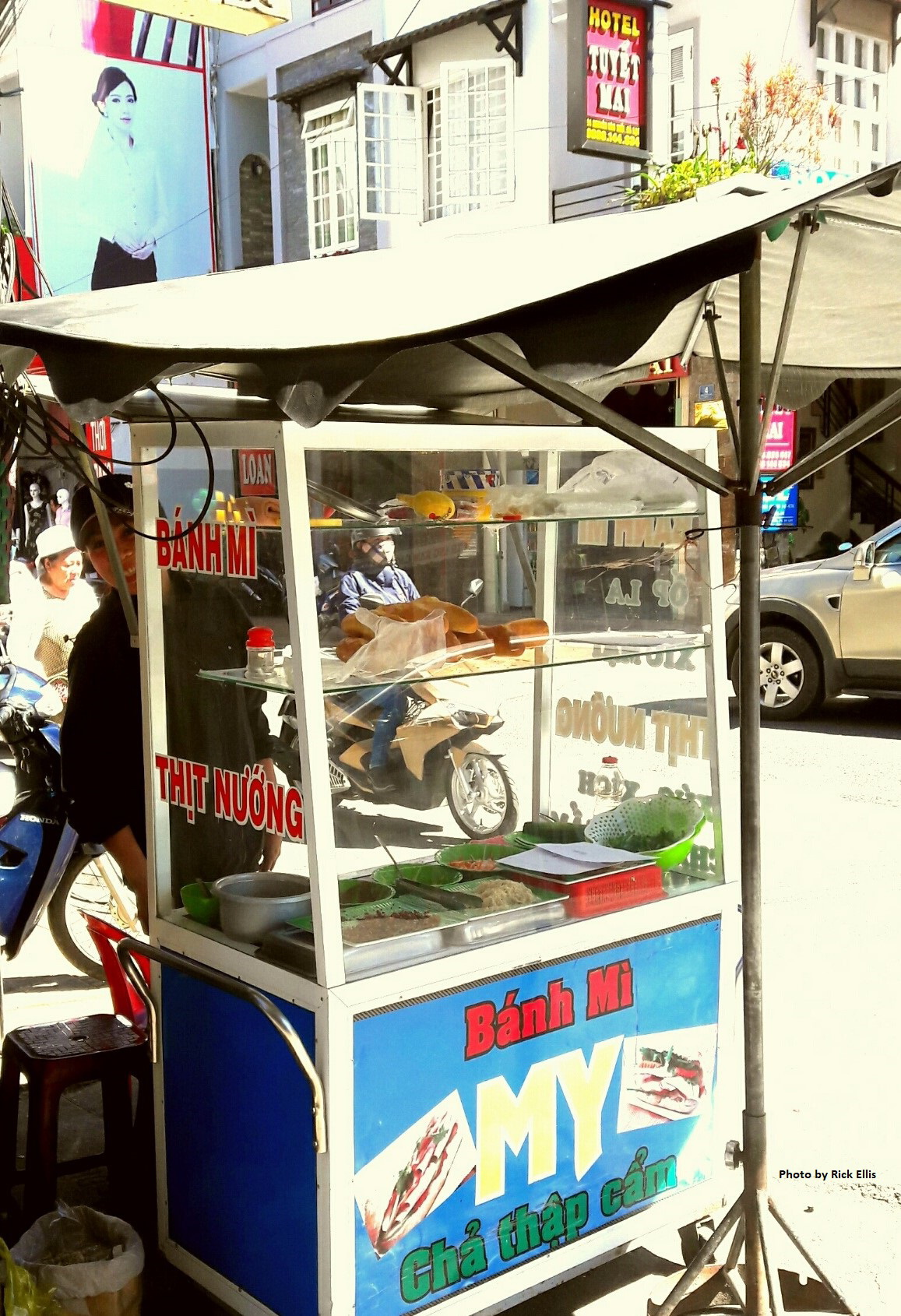 Local Banh Mi vendor and her cart