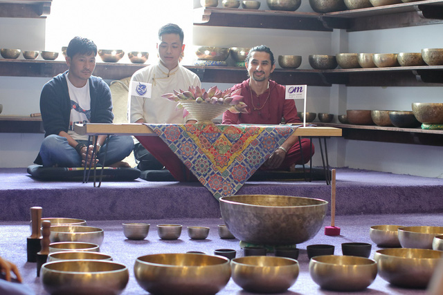 Men sit at a center of Nguyen Manh Duy which offers treatment with Tibetan singing bowls in Ho Chi Minh City, Vietnam. Photo courtesy of Duy