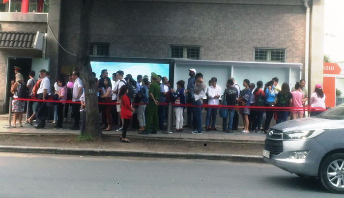 Middlemen sell queue tickets in front of Chinese Consulate General in Ho Chi Minh City