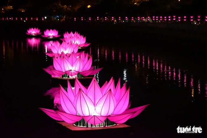 Seven large lotus-shaped lanterns by Quan Am Monastery are seen on Nhieu Loc – Thi Nghe Canal in Ho Chi Minh City. Photo: Tuoi Tre