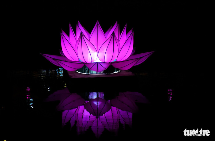 One of the seven large lotus-shaped lanterns by Quan Am Monastery is seen on Nhieu Loc – Thi Nghe Canal in Ho Chi Minh City. Photo: Tuoi Tre