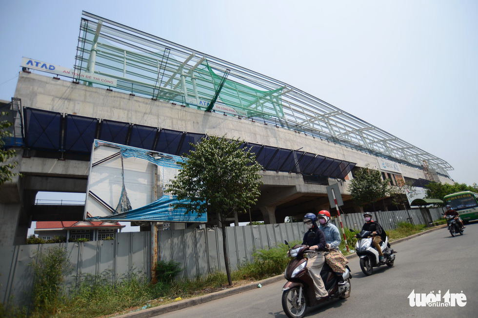 A billboard providing information on Ho Chi Minh City's metro project is badly damaged after years in the weather. Photo: Tuoi Tre