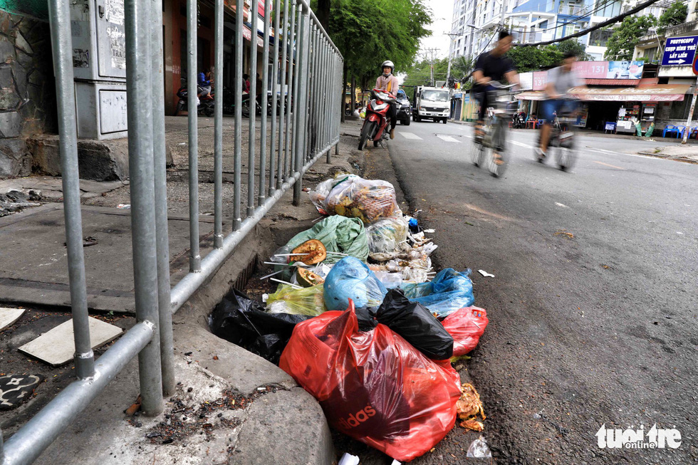 Countless bags of rubbish are dumped at a sewer on Nguyen Khoai Street in District 4.