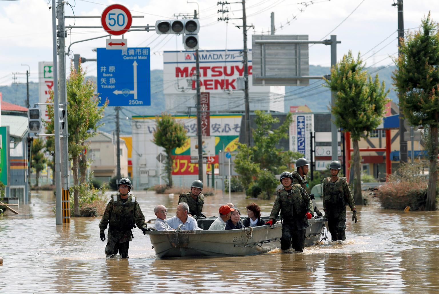 'Unprecedented' rain strands at least 1,000, kills at least 66 in Japan