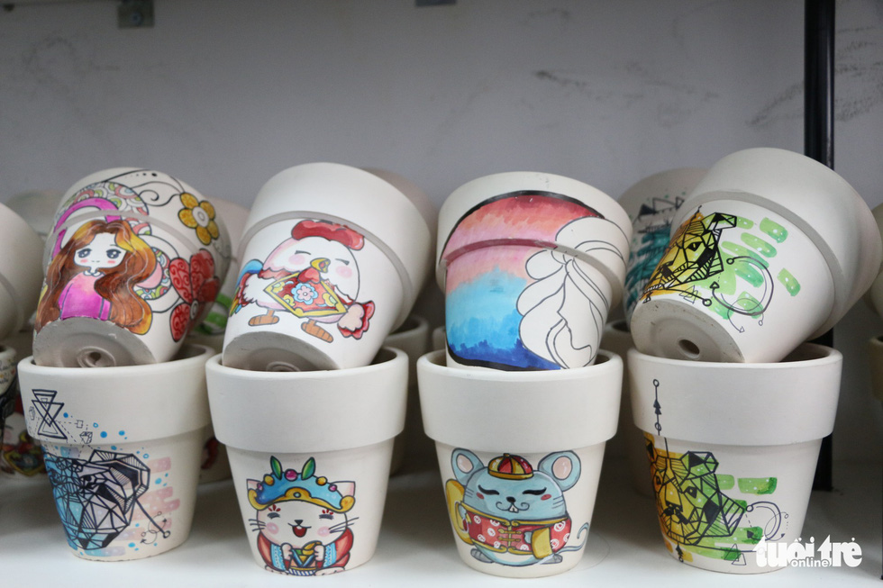 "Plant pots are decorated with adorable images in the lovely ""chibi"" art style at Joy Garden. Photo: Tuoi Tre"