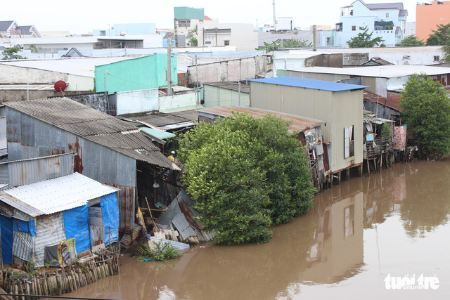 Residents take fright as houses sink into water overnight in southern Vietnam