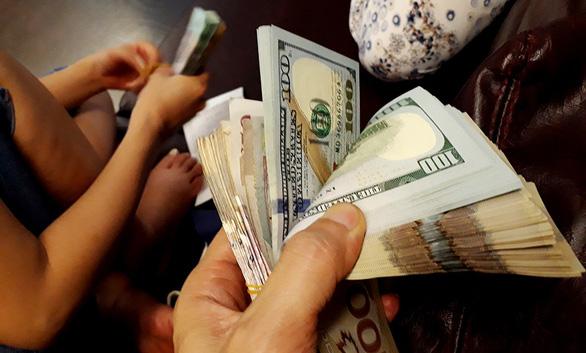 A stack of dollar bills. Photo: Tuoi Tre