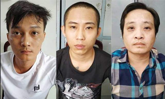 The three suspects are held at the police station in this photo provided by officers.