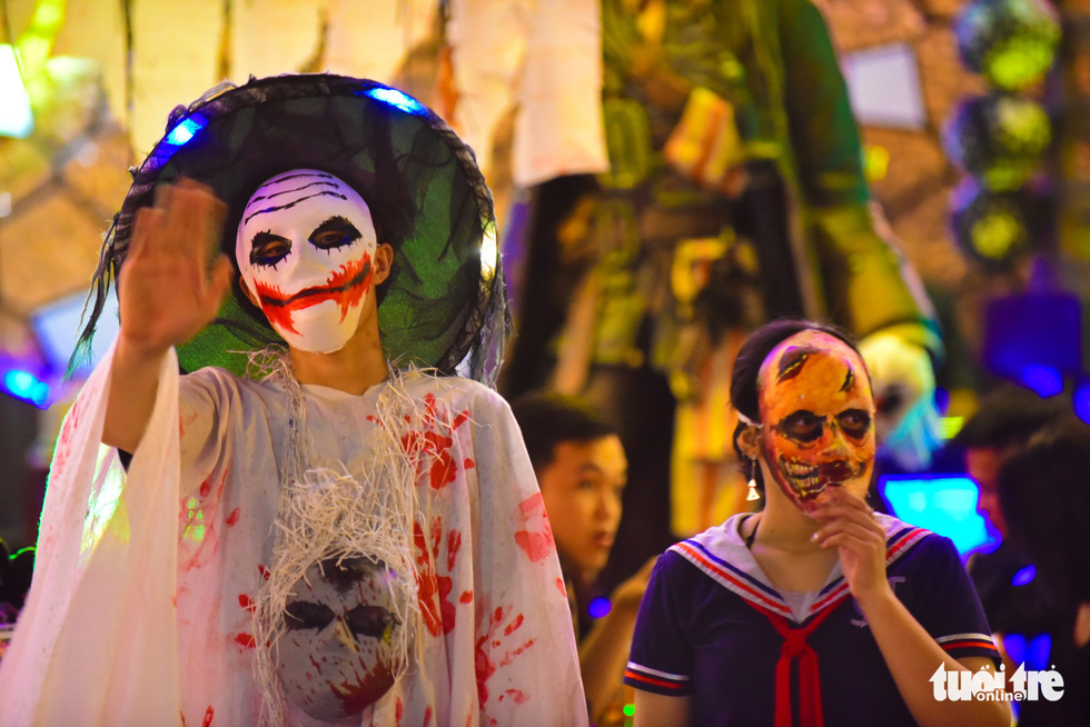 Attendants of a restaurant in Bui Vien Street dress in spooky costumes for Halloween. Photo: Tuoi Tre