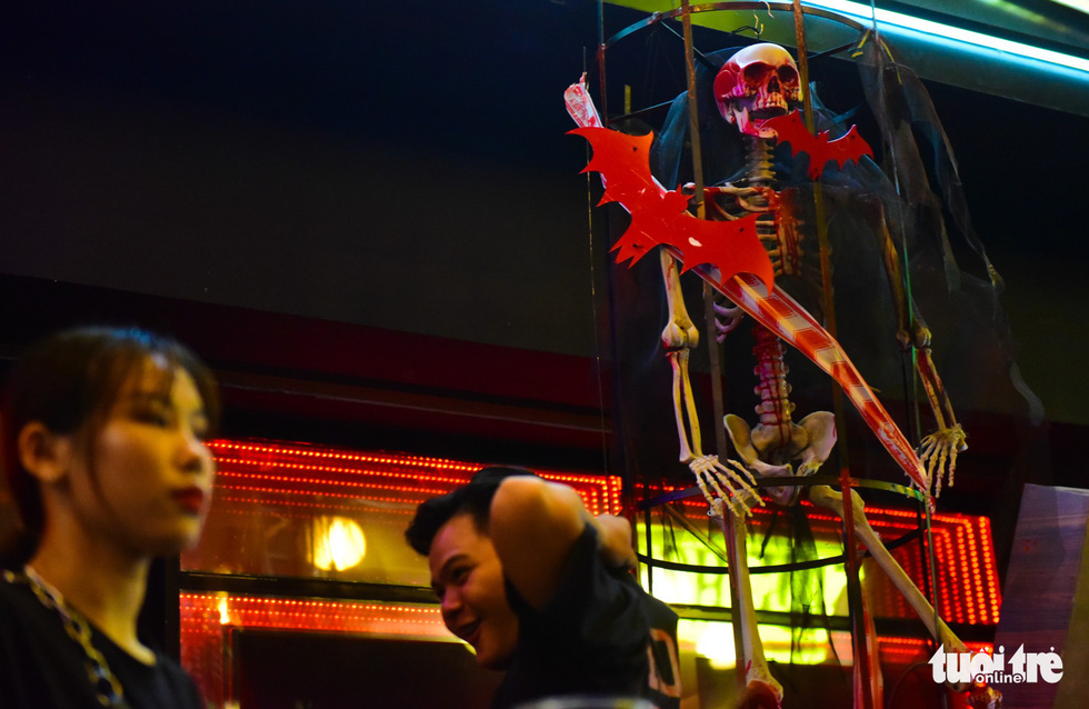 A skeleton is hung at a restaurant in Bui Vien Street. Photo: Tuoi Tre