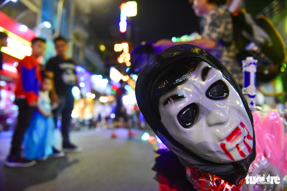 Ghost masks are sold in Bui Vien Street. Photo: Tuoi Tre