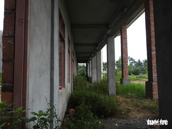 Weeds grow around the building, seen in rural Hai Phong City, northern Vietnam. Photo: Tuoi Tre