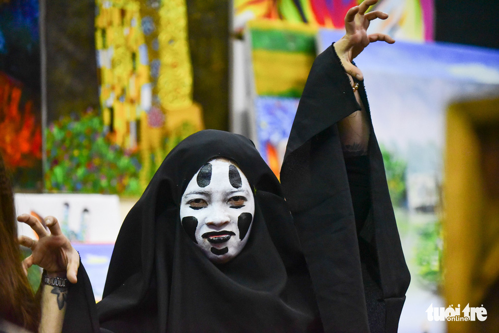 "A woman masquerades as No-Face, a character in the 2001 Japanese animated coming-of-age fantasy film ""Spirited Away."""