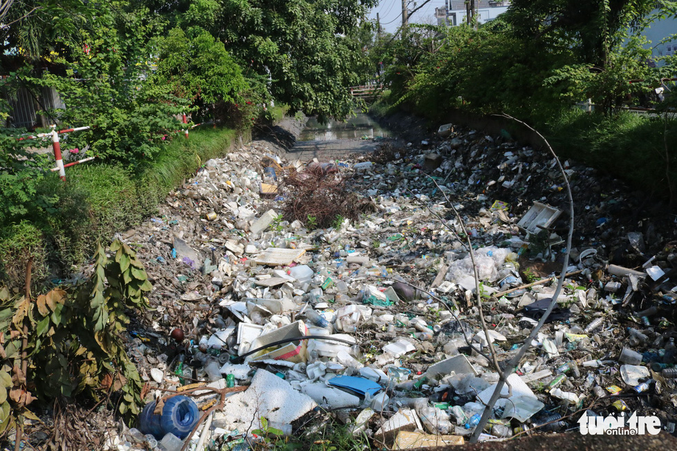 A canal in Tan Phu District is filled with trash.