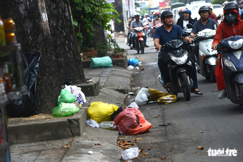 Commuters have to avoid rubbish dumped on the roadway.