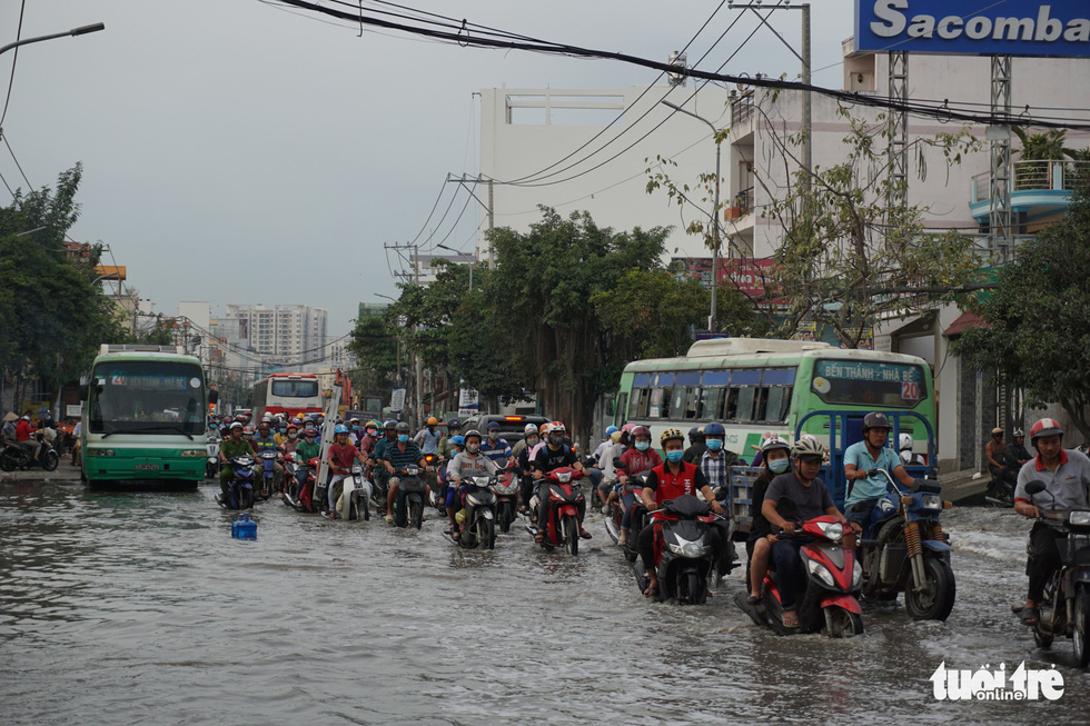 People travel on Huynh Tan Phat Street in District 7.