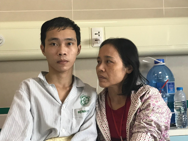 Hoang Dinh Hien with his mother at a hospital in northern Vietnam. Photo: Tuoi Tre