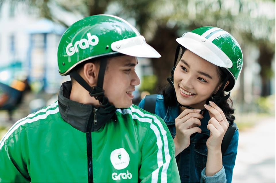 Vietnamese Grab users accuse ride-hailing app of forced use of e-wallet