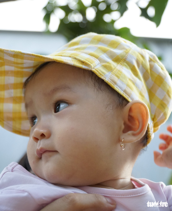 A baby wears a hat made in the Long Khanh weaving village in Dong Thap Province, southern Vietnam. Photo: Tuoi Tre