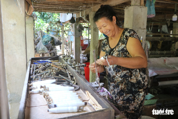 A woman winds thread at her workroom in the Long Khanh weaving village in Dong Thap Province, southern Vietnam. Photo: Tuoi Tre