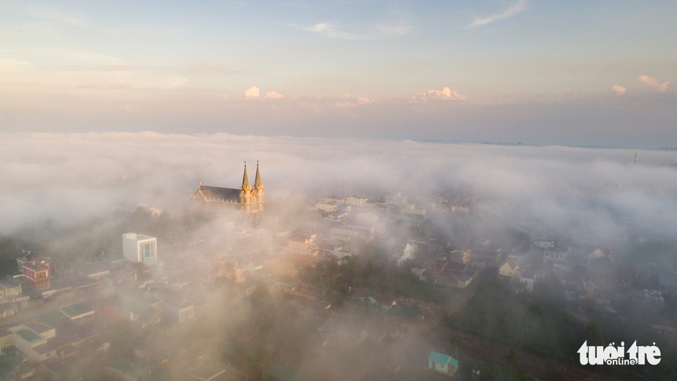 A church rises above the clouds in Bao Loc City. Photo: Le Van Cuong