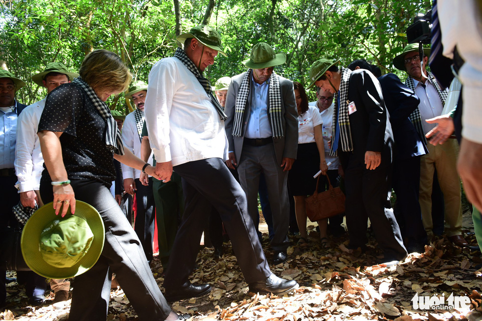 The president and his spouse take a tour of the Cu Chi Tunnels.
