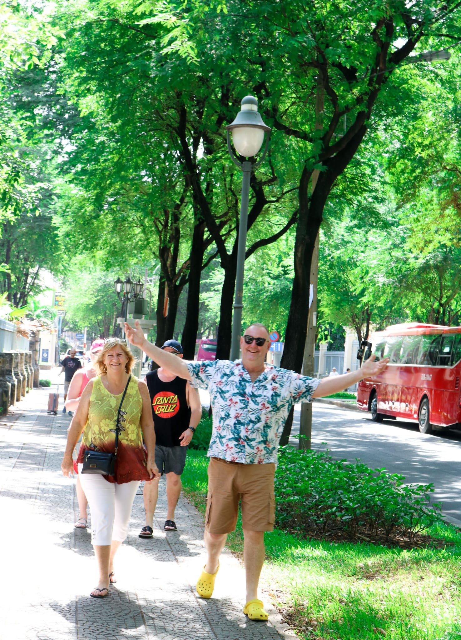 Foreigners are seen walking on a street with tamarinds in Ho Chi Minh City, Vietnam. Photo: Tuoi Tre