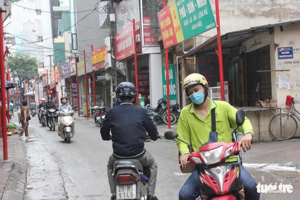 Motorbikes run on Dinh Thon Street in Hanoi, Vietnam. Photo: Tuoi Tre