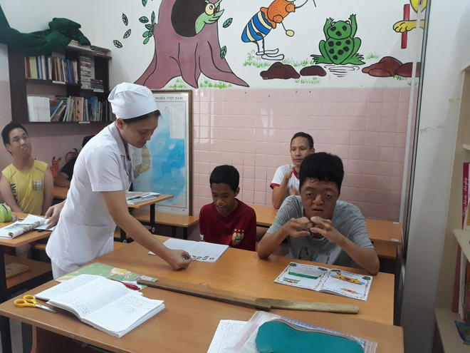 A class with disabled children and orphans at Hoa Binh Village. Photo: Tuoi Tre