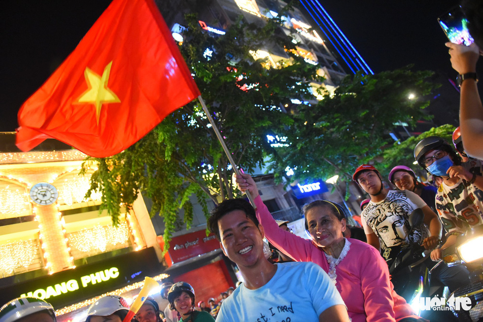 Football fans in Ho Chi Minh City celebrate Vietnam's 2-0 victory against Malaysia