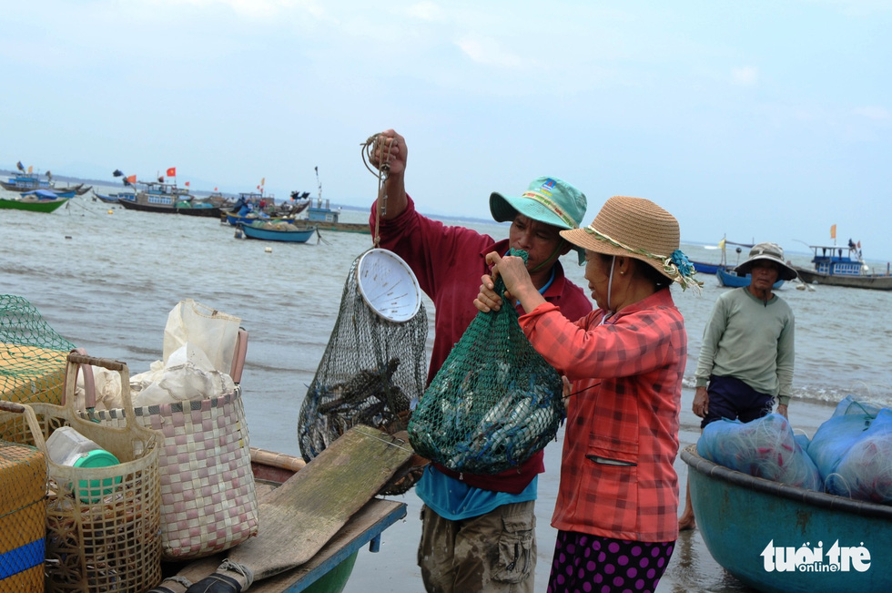 Local fishers and their catches following a journey at sea
